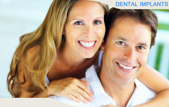 Patients in Beverly Hills California smiling after receiving dental implants.